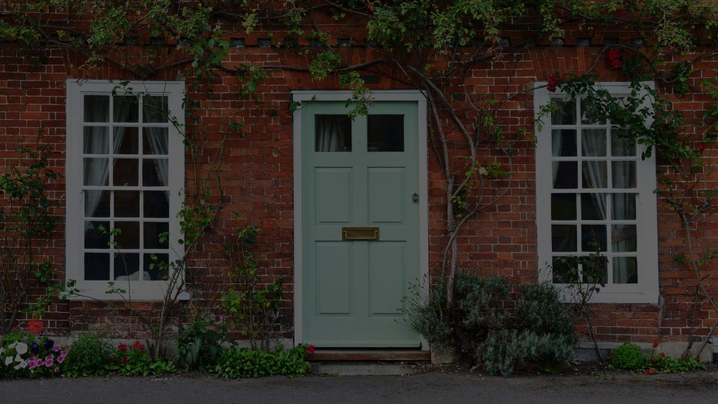 View of a Beautiful House and Front Door on a London Street with Sash Windows.
